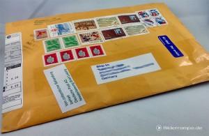 Umschlag mit Briefmarken-Sammlung